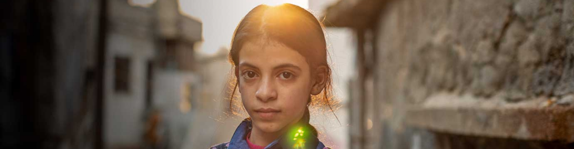 Nine years of conflict weigh heavily on Syrian refugee girl