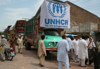 A convoy of UNHCR trucks loaded with relief items for flood survivors in Charsad
