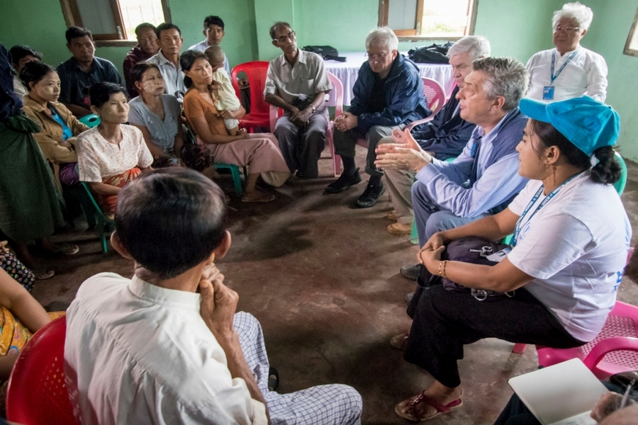 Villagers in a Rakhine village north of Maungdaw share their fears with the High Commissioner.  © UNHCR/Roger Arnold