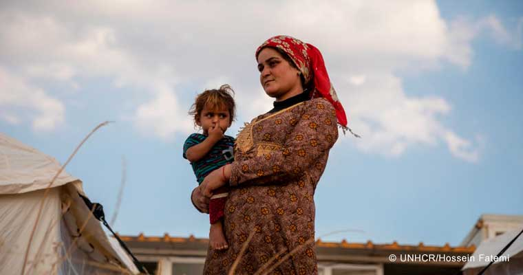 A recently arrived Syrian refugee mother and child at Bardarash camp in Duhok, Iraq.  © UNHCR/Hossein Fatemi