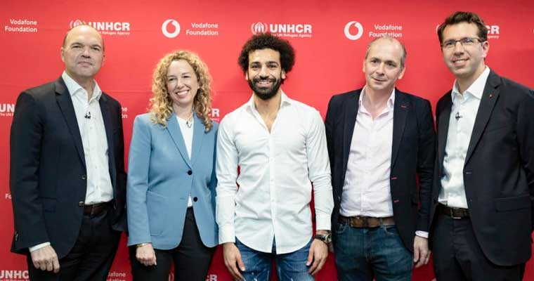 Football star Mohamed Salah (centre) poses with (from left to right) Nick Read, CEO, Vodafone Group; Dominique Hyde, Director of External Relations, UNHCR, the UN Refugee Agency; Andrew Dunnett, Director SDGs, Sustainable Business & Foundations, Vodafone Group; and Alex Froment-Curtil, CEO, Vodafone Egypt.  © UNHCR/Vodafone Foundation/Mike Dodd