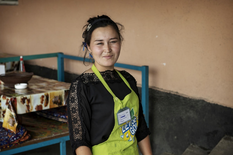 Previously stateless, Nazgul Avaz Kyzy, 22, is now a full citizen of Kyrgyzstan and able to work legally at a local café.   © UNHCR/Chris de Bode