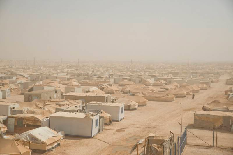 A wide view of Za'atari refugee camp shows mixed tent and caravan areas. UNHCR / J. Kohler